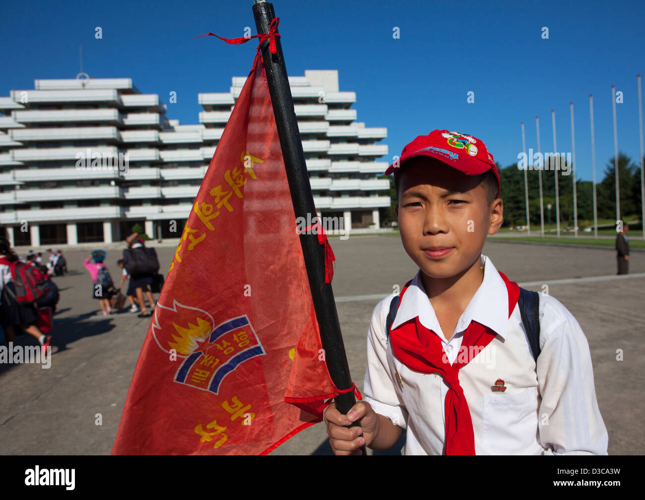 Pioneer Holding A Flag At Songdowon International Children's Camp, Wonsan, North Korea, North Korea Stock Photo