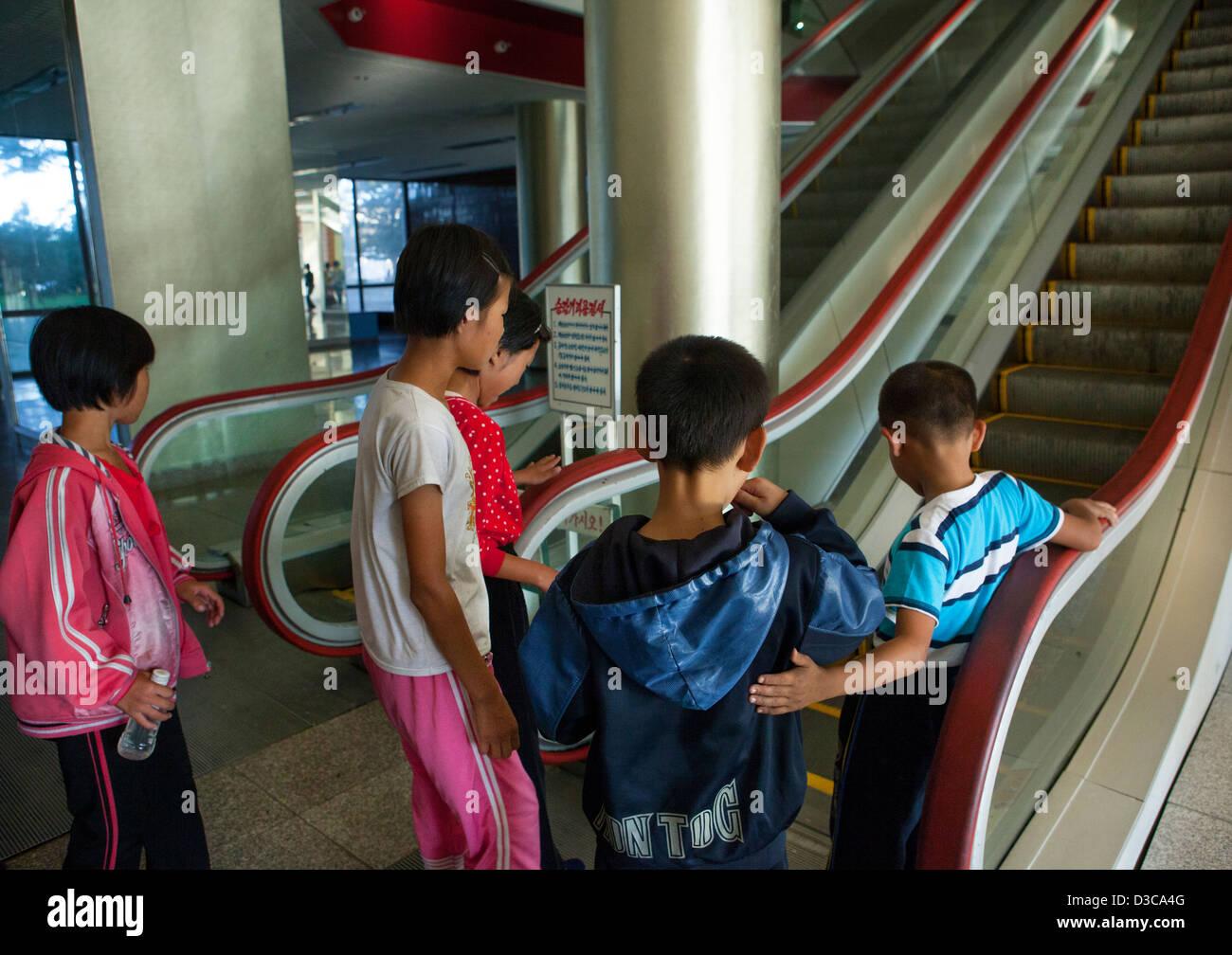 Kids Afraid Of An Escalator In Songdowon International Children's Camp, Wonsan, North Korea, North Korea Stock Photo
