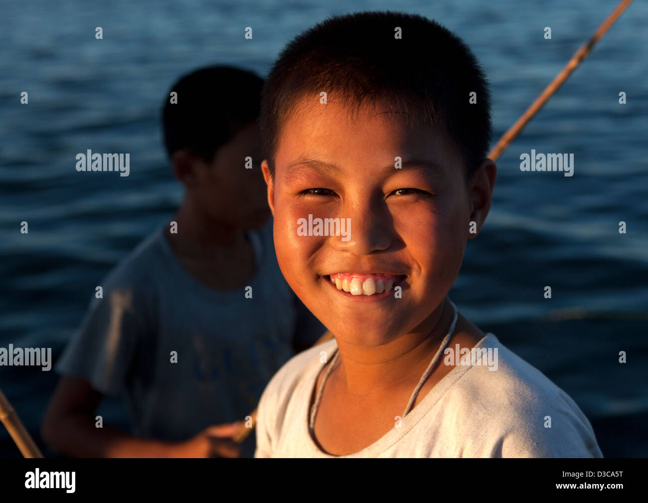 Kids Fishing, Wonsan, North Korea - Stock Image