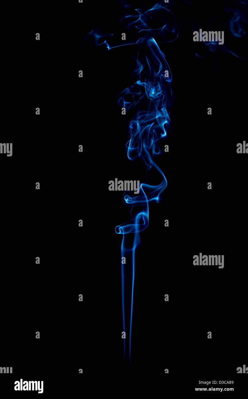 blue rings and curls of smoke on black background - Stock Image