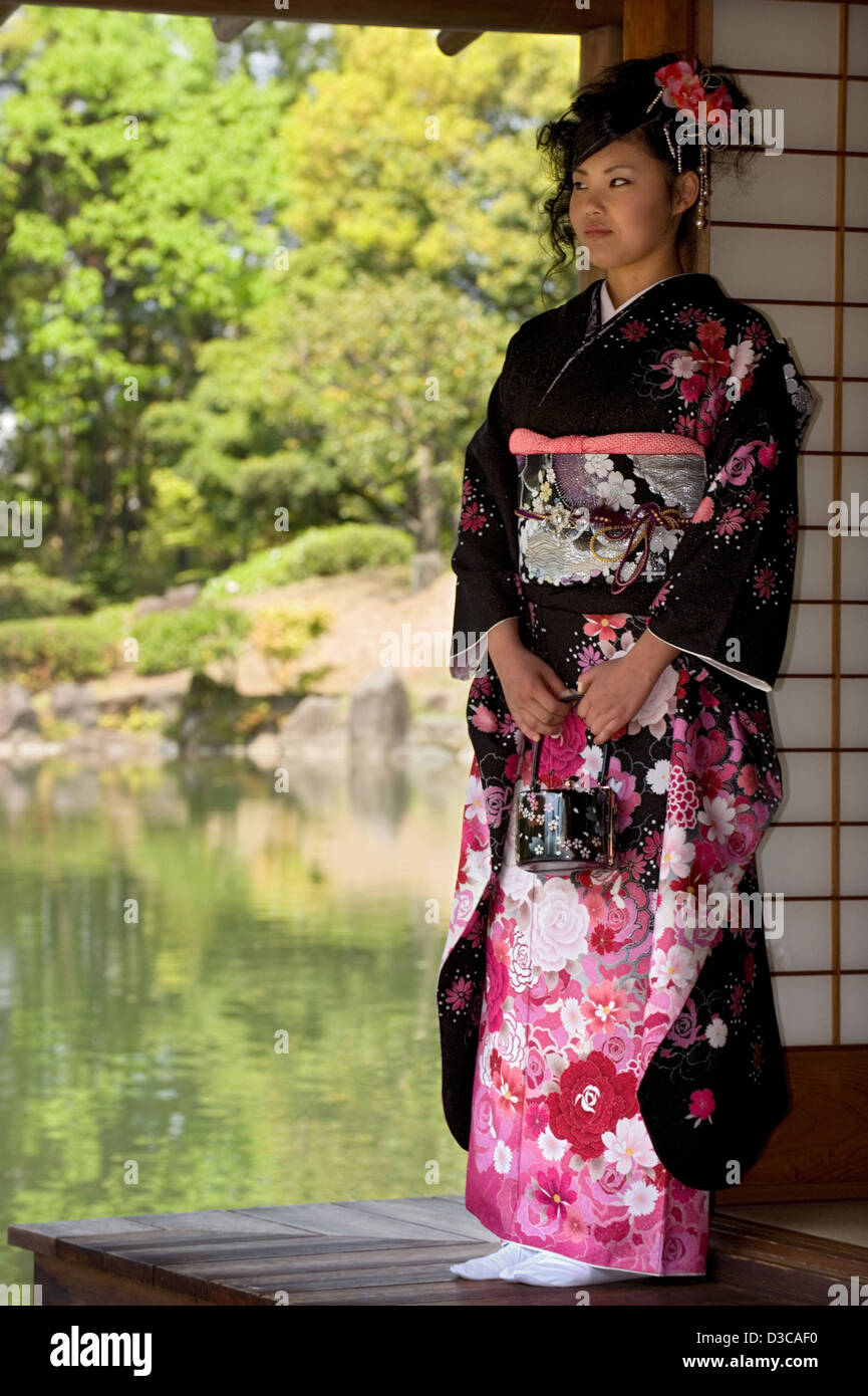 beautiful 19-year-old japanese girl wearing traditional furisode