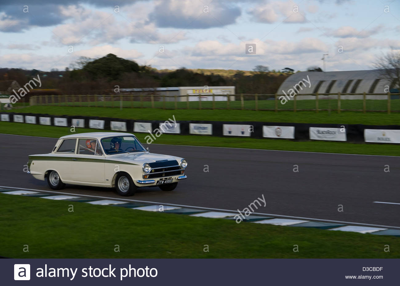 Lotus Cortina at speed Goodwood West Sussex England - Stock Image