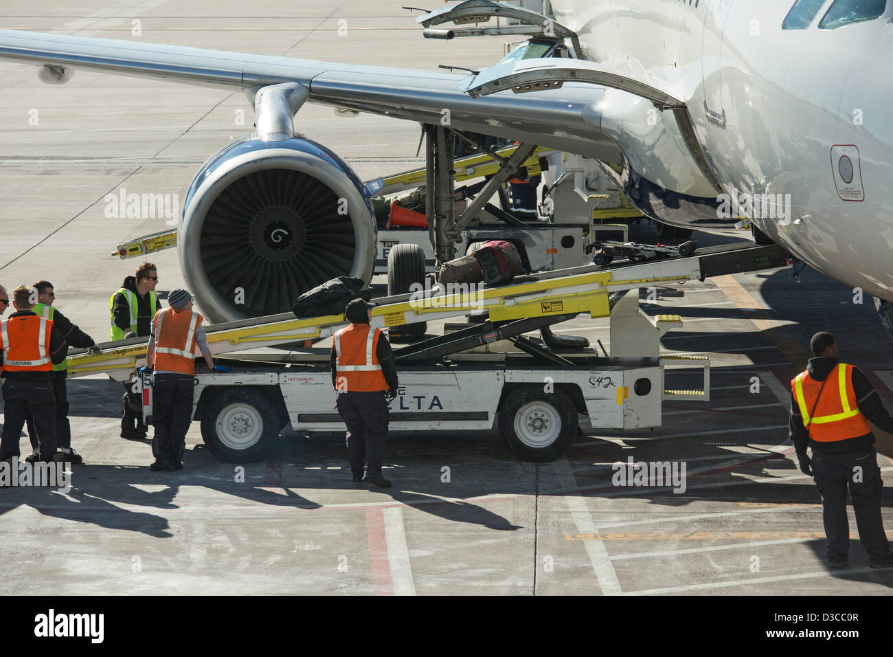 Denver, Colorado   The Ground Crew Unloads Luggage From A Delta Airlines  Plane At Denver
