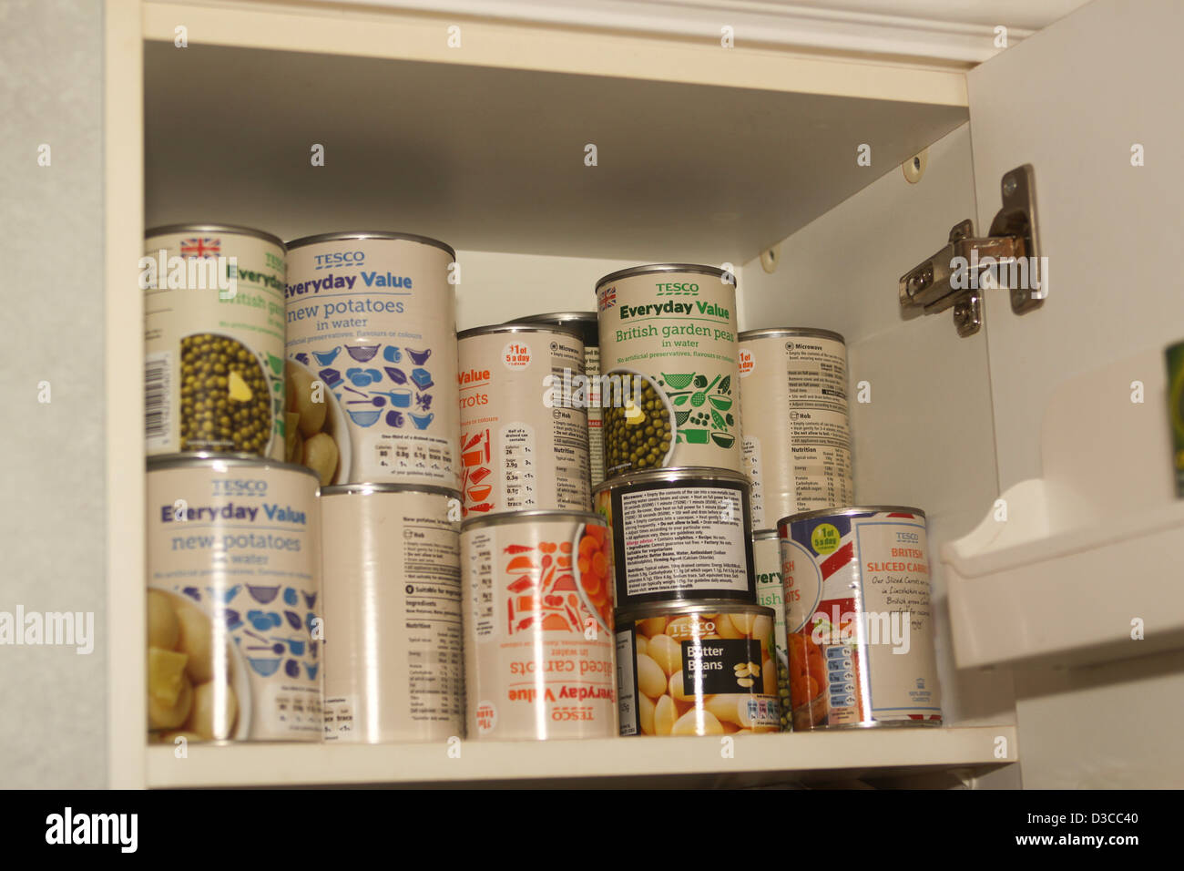 Tesco value tinned foods in kitchen cupboard - Stock Image