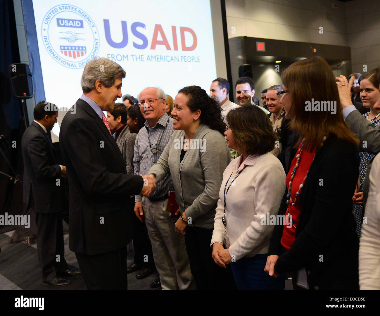 US Secretary of State John Kerry greets employees of the U.S. Agency for International Development (USAID) at the - Stock Image