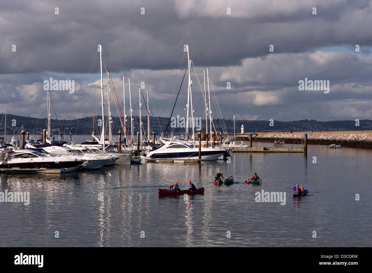 Brixham marina,Breakwater,Brixham Harbour, anchored, blue, boat, bow, choppy, docked, fluid, green, launch,  Fish - Stock Image