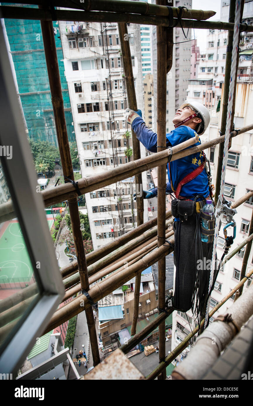 Bamboo scaffolding built up around the Kiu Fat Building ,still being used for its durability, lightness and flexibility. - Stock Image