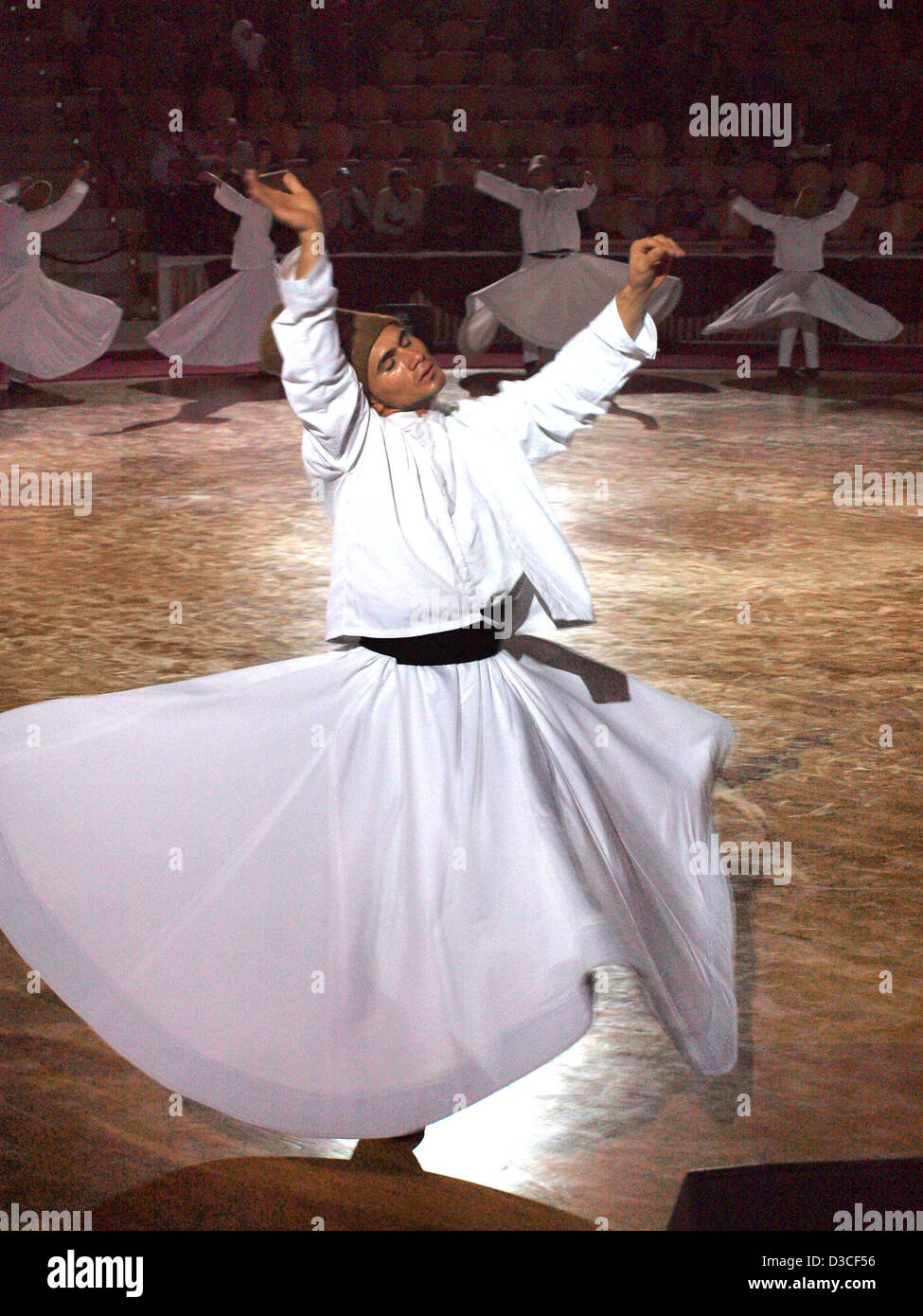 Sufi whirling dervishes in Konya, Turkey, during the annual Mevlana Festival, which takes place in early December. - Stock Image