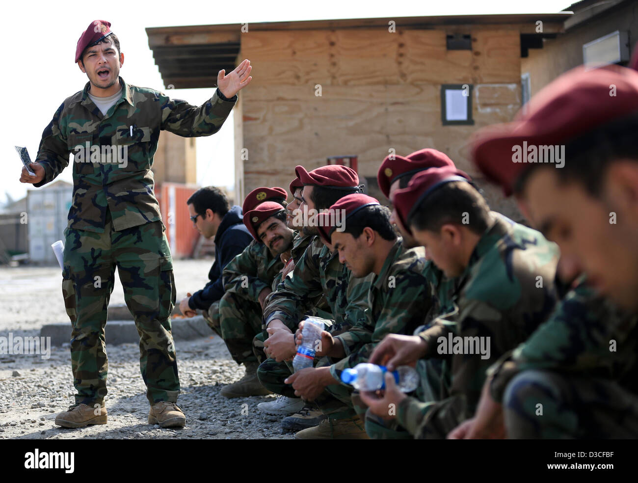 An Afghan National Army commando platoon sergeant briefs soldiers before training exercises February 11, 2-13 drills - Stock Image
