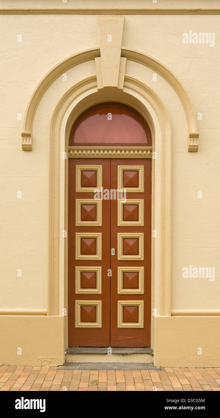 Immaculate brown and cream painted arched double wooden doors with ...