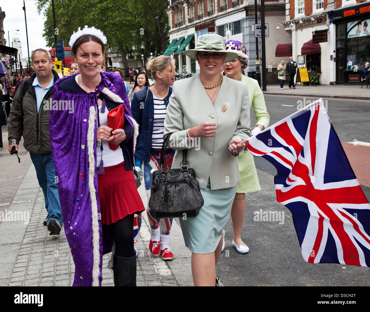 People walking to the Queen's Diamond Jubilee party at Hyde Park, London, UK - Stock Image