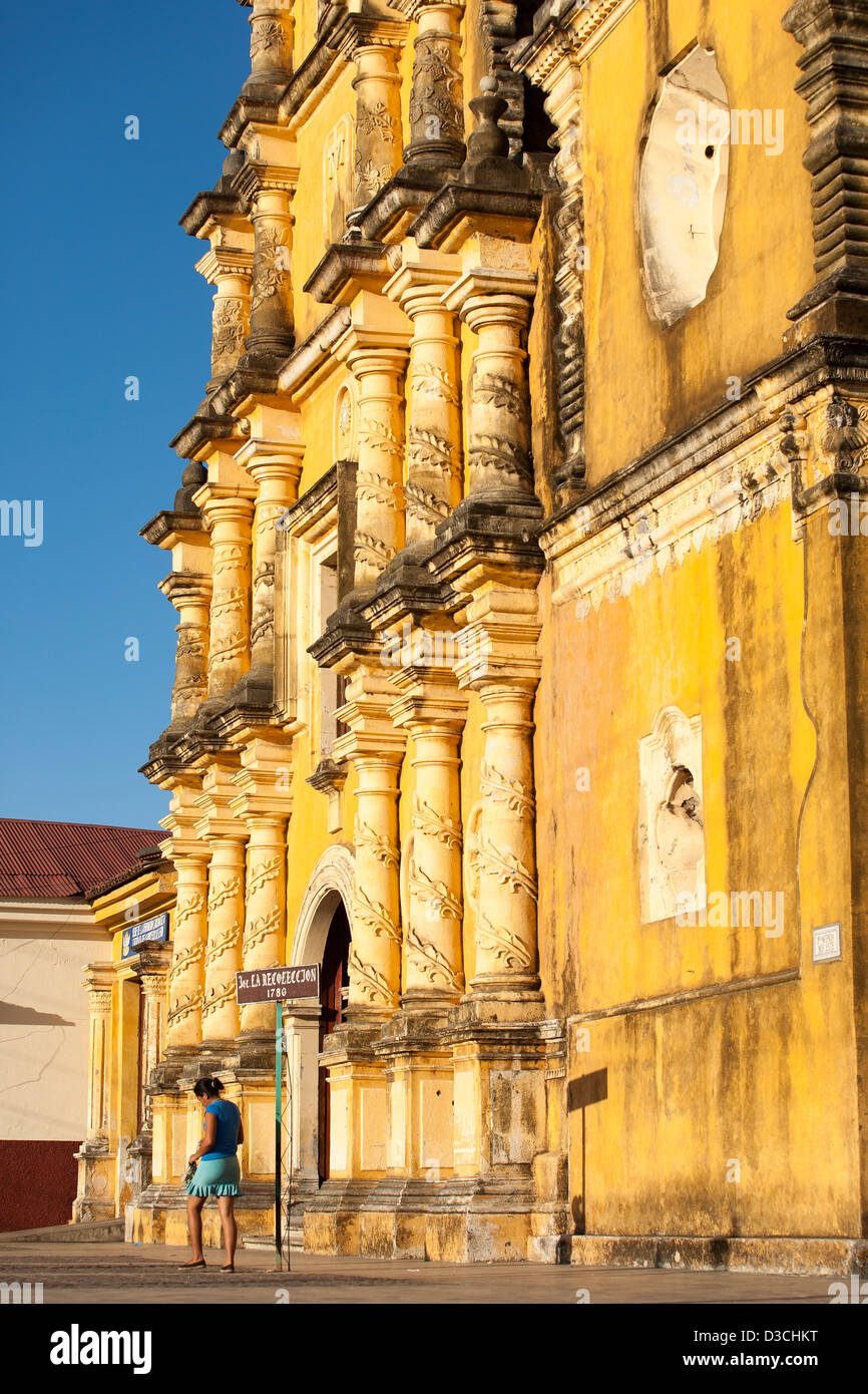 The bright yellow facade of Iglesia La Recoleccion a well known and spectacular church in Leon Nicaragua - Stock Image