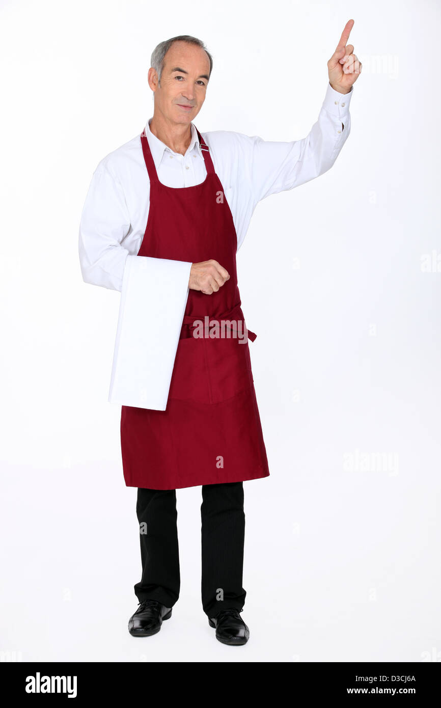 Waiter pointing - Stock Image