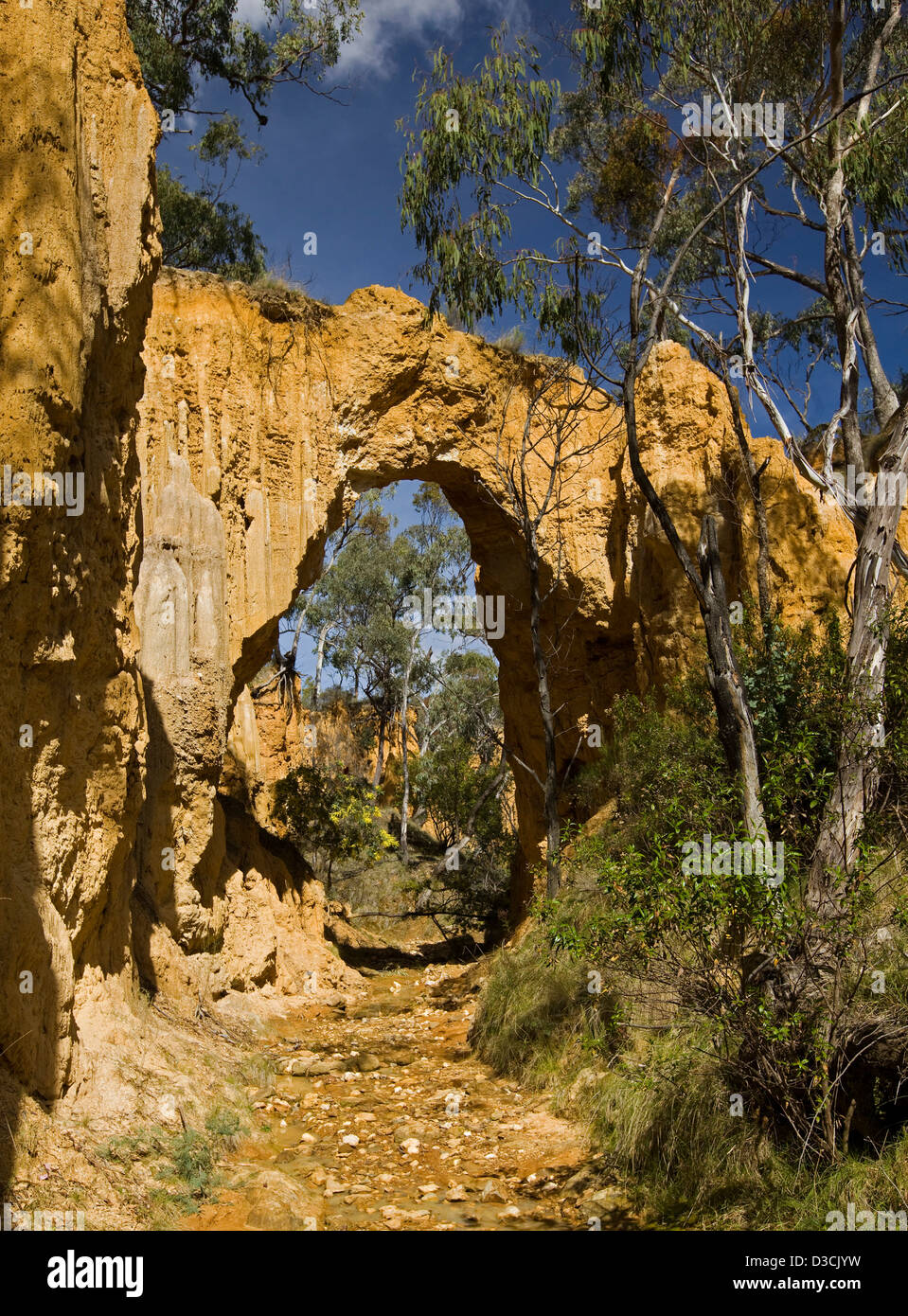 Nature arch carved by wind and water erosion along creek at Golden Gully - former gold mining area near Hill End - Stock Image