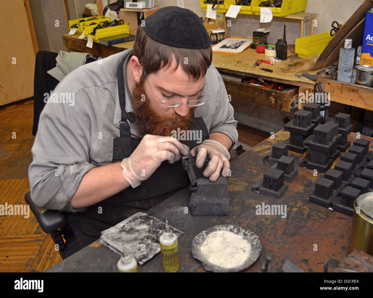 Making phylacteries (teffilin) at Hasofer, a scribe shop, on Kingston Avenue in the Crown Heights section of Brooklyn. - Stock Image