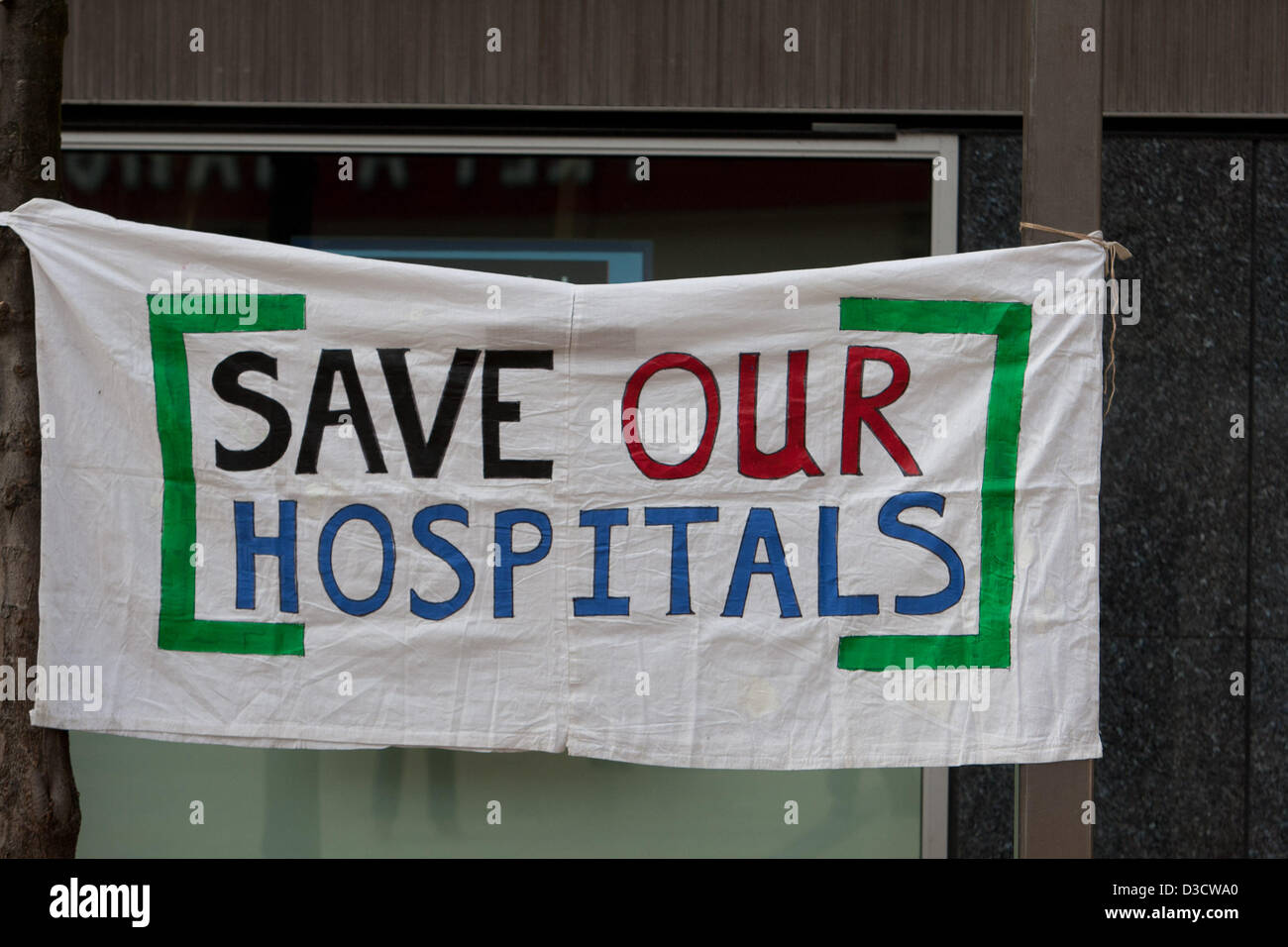 Hammersmith, London, UK. 16th February 2013. Save our hospitals banner at rally as NHS announce closure of A&E - Stock Image