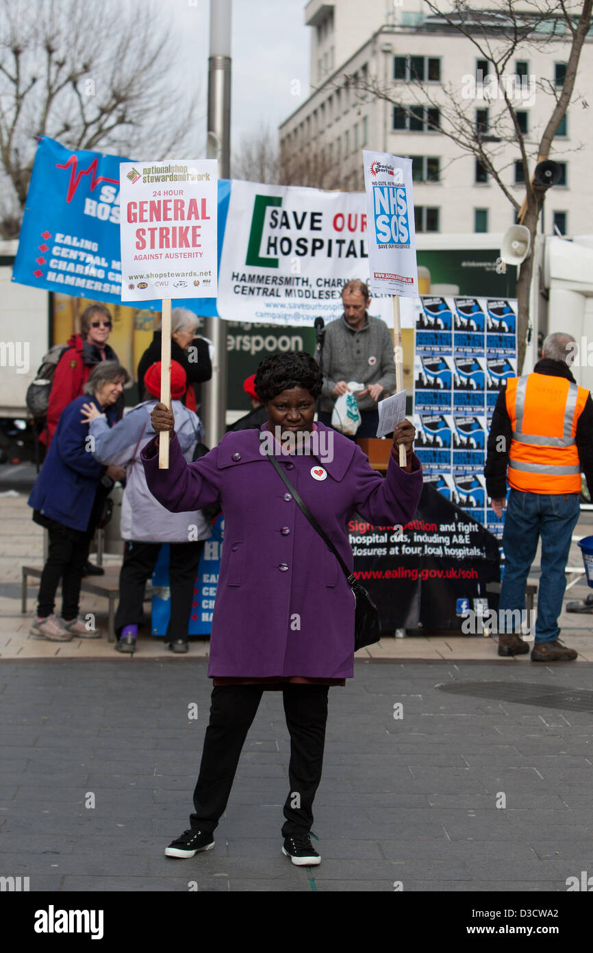 Hammersmith, London, UK. 16th February 2013. Woman holding placards at rally as NHS announce closure of A&E - Stock Image