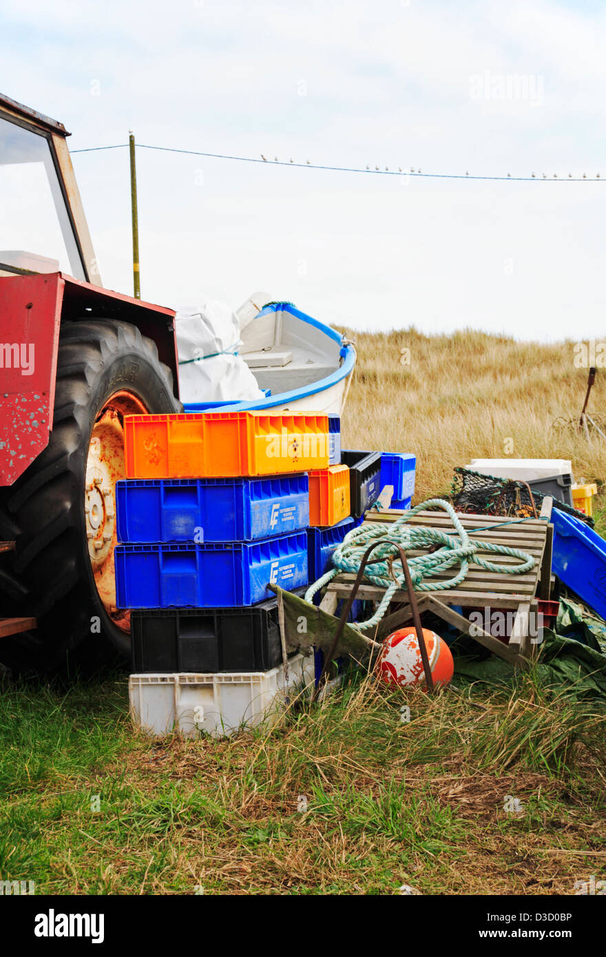 A view of a tractor, boat and equipment for an inshore fisherman at Caister-on-Sea, Norfolk, England, United Kingdom. Stock Photo