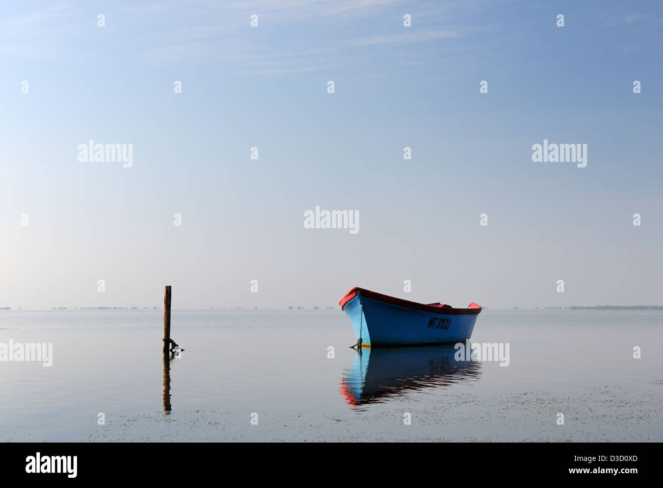 Fishing boat in a lagune. - Stock Image
