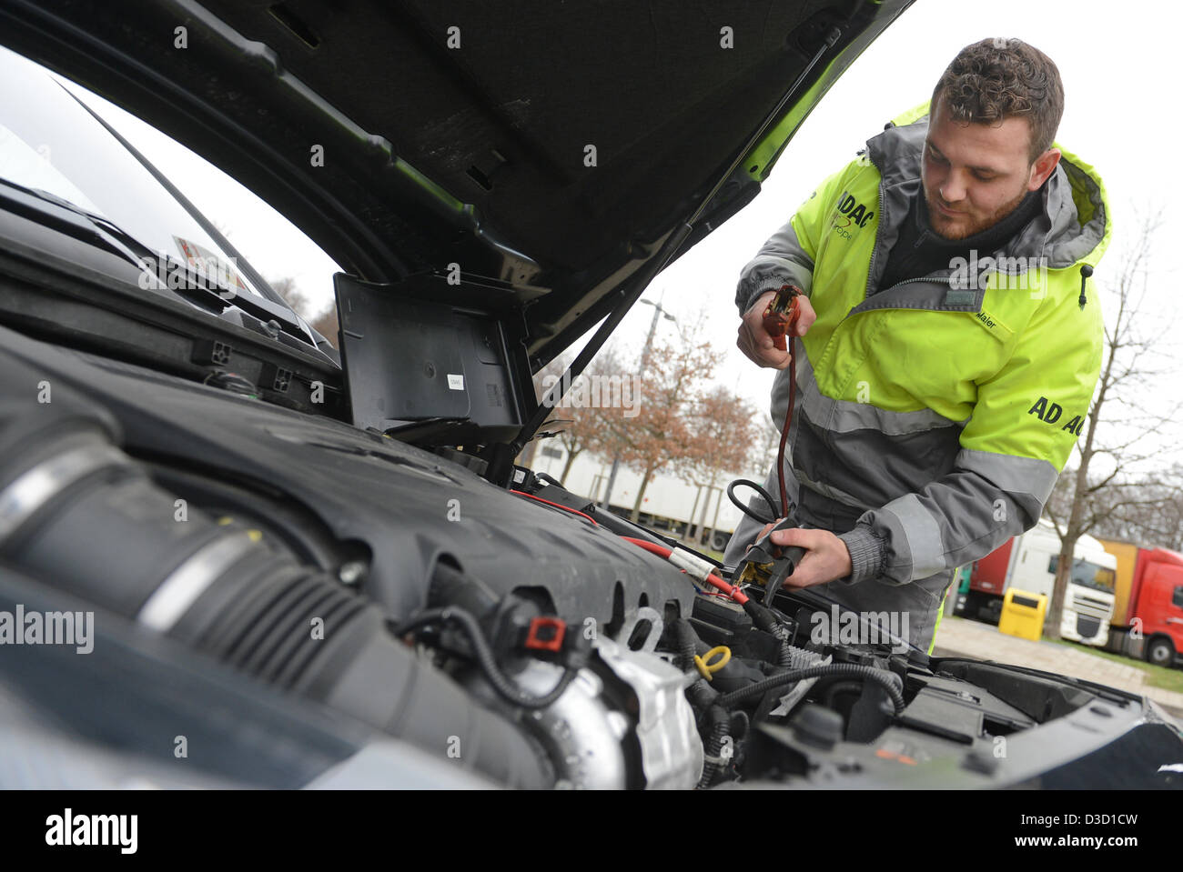 ADAC road patrol driver Kai Maier shows how to short a car battery in Leonberg, Germany, 05 February 2013. Krämer Stock Photo