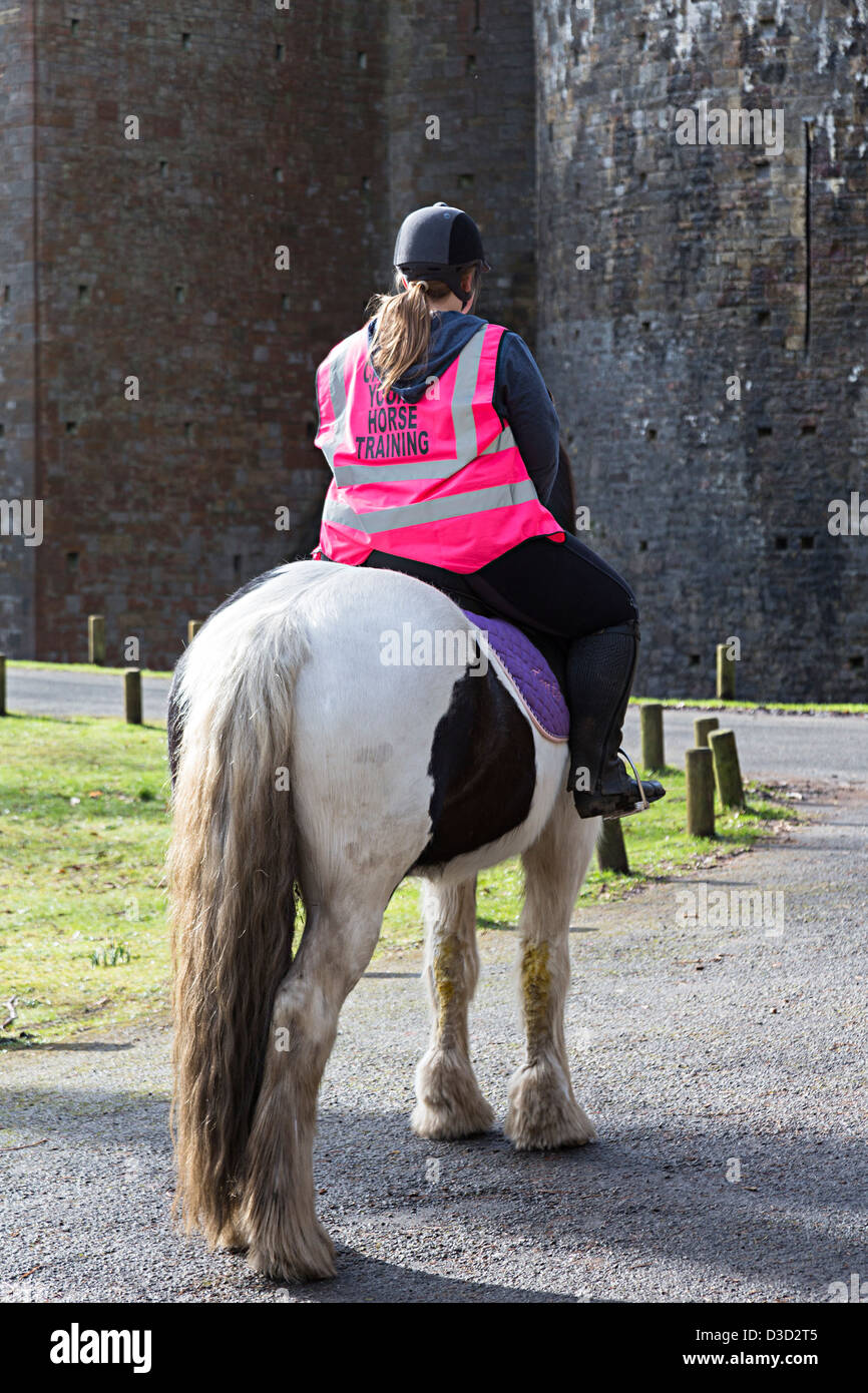 Horse and rider with training sign on jacket pony trekking, Tongwynlais, Cardiff, Wales, UK - Stock Image
