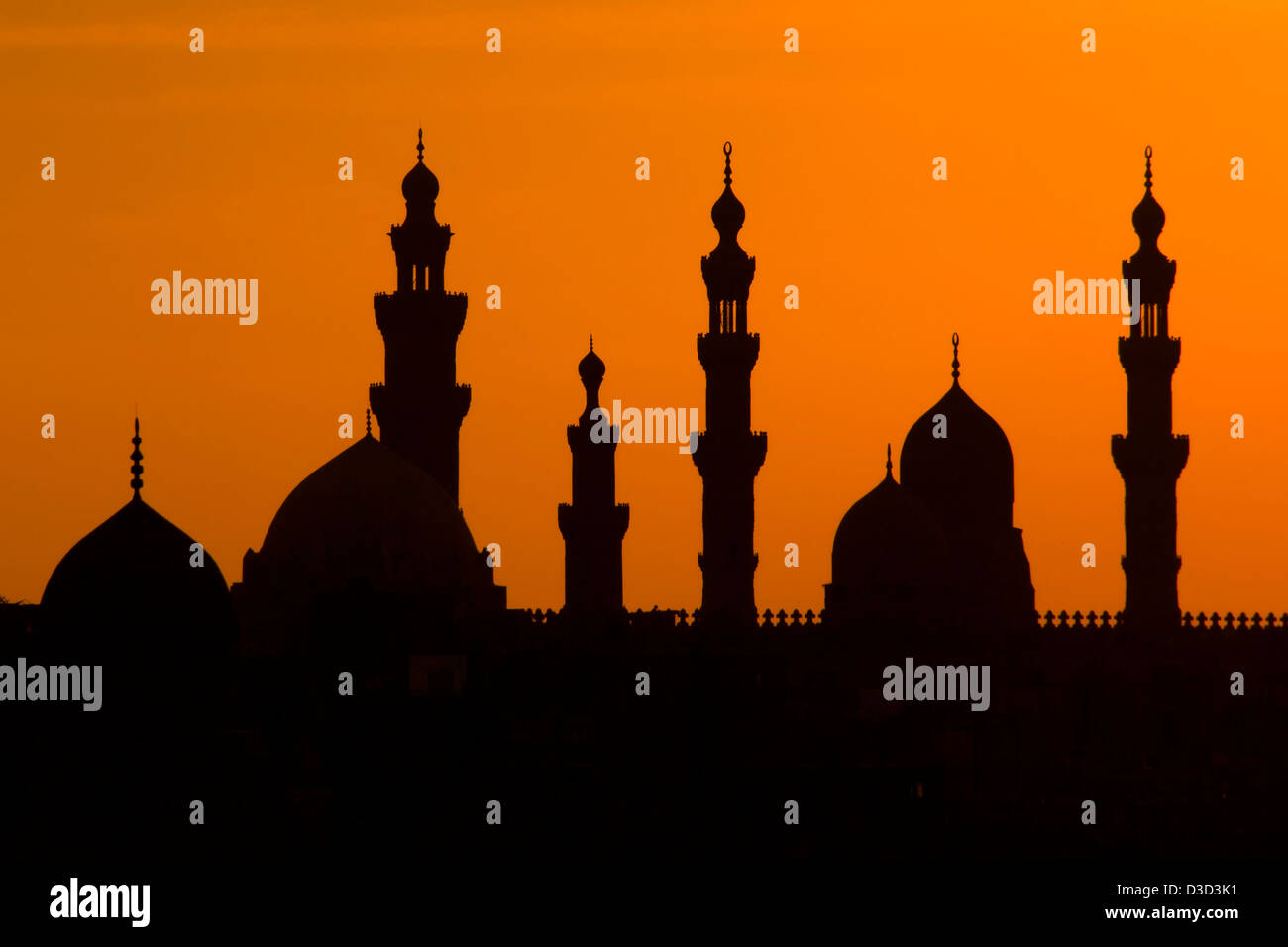 The Sultan Hassan Mosque silhouetted at sunset. Islamic Cairo, Egypt - Stock Image