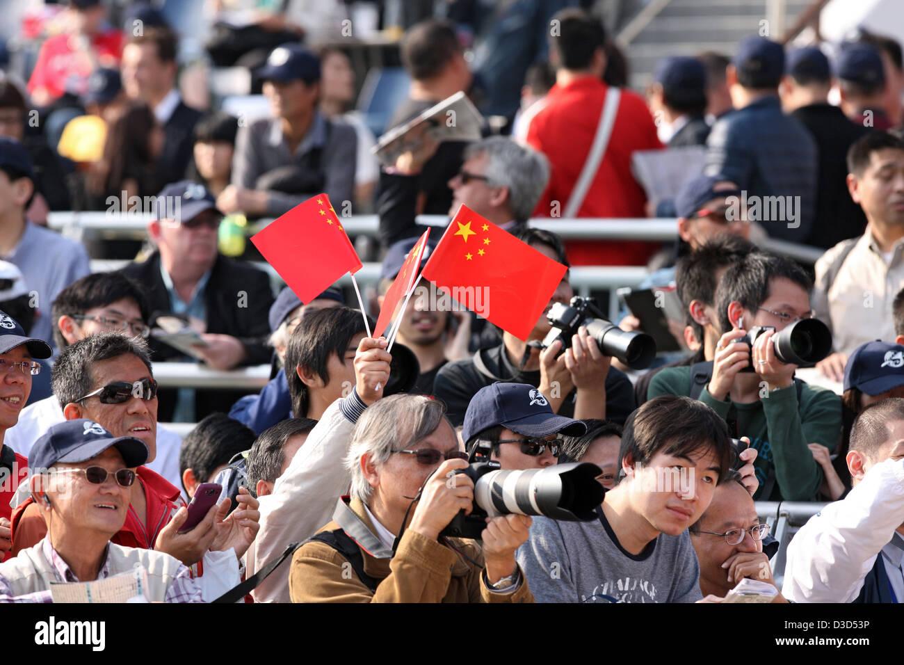 Hong Kong, China, man swings Nationalfaehnchen the People's Republic of China - Stock Image