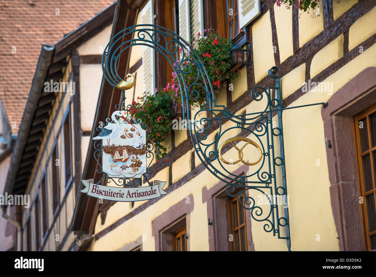 Inn sign of Biscuitere Artisanale in Kaysersberg, along the Wine Route, Alsace Haut-Rhin France Stock Photo