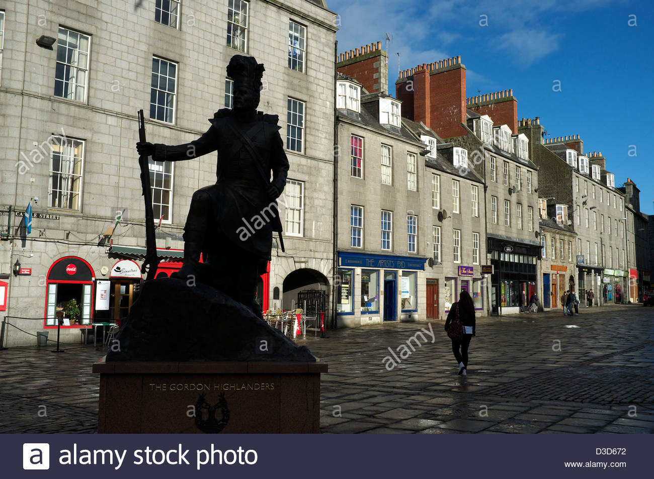 Gordon Highlanders statue silhouetted against a row of buildings in Castle Street in Castle Square, Aberdeen, Scotland, - Stock Image