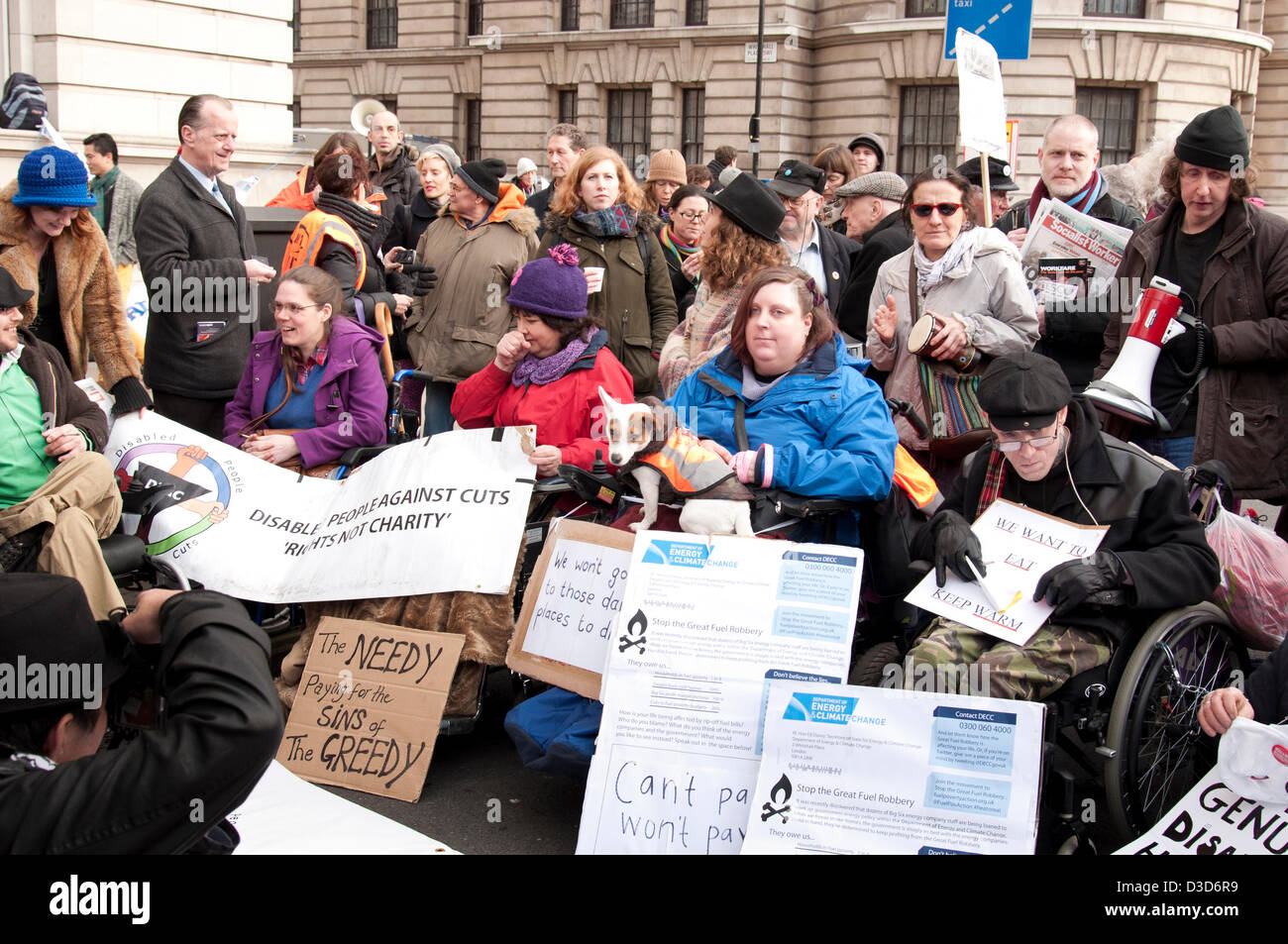 London UK. 16th February 2013.  A sit in protest led by the Disabled Peoples Direct Action Network stops traffic - Stock Image