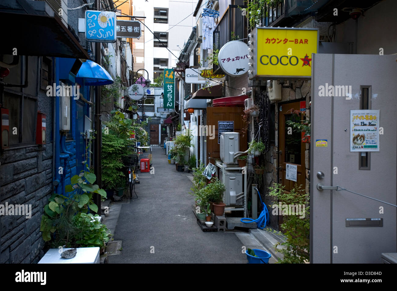 Narrow backstreet alley of bygone-era bars, pubs and eateries from 1950's in the Golden-Gai neighborhood of - Stock Image