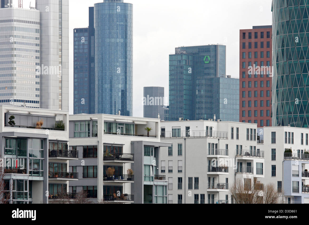 Frankfurt am Main, Germany, Appartmenthaeuser the Western Harbour, behind the towers of the financial district Stock Photo
