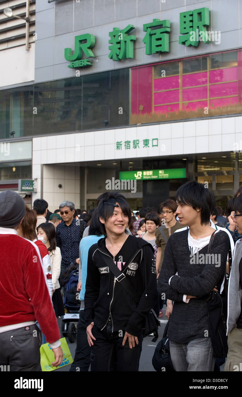 Fashionable young people seen in front of the ever popular hangout location at East Shinjuku train station in Tokyo, - Stock Image