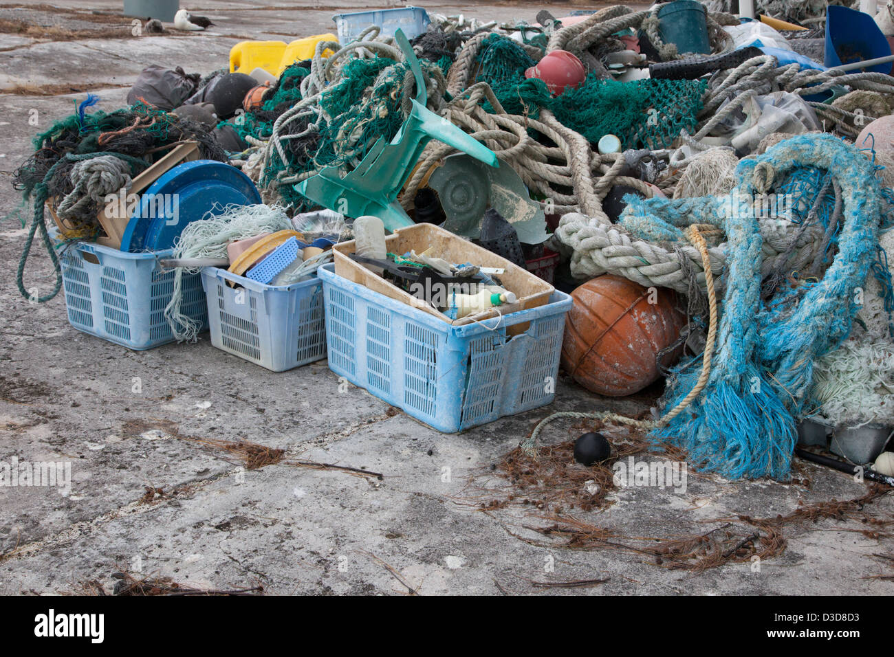 Marine debris brought to Midway Atoll by ocean currents then collected to be shipped off island for recycling or - Stock Image