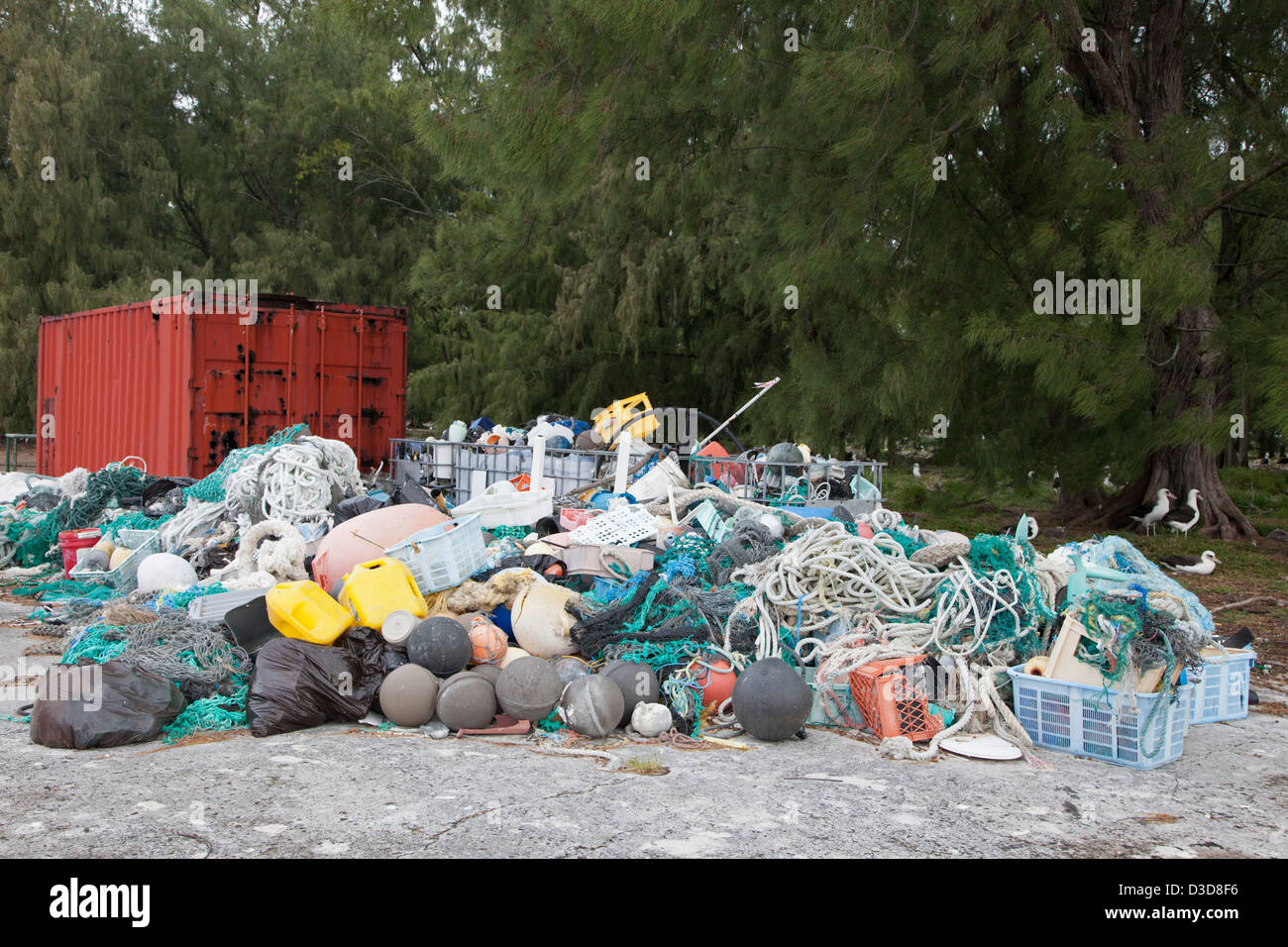 Marine debris brought to Midway Atoll by currents then collected to be shipped off island for recycling or disposal - Stock Image