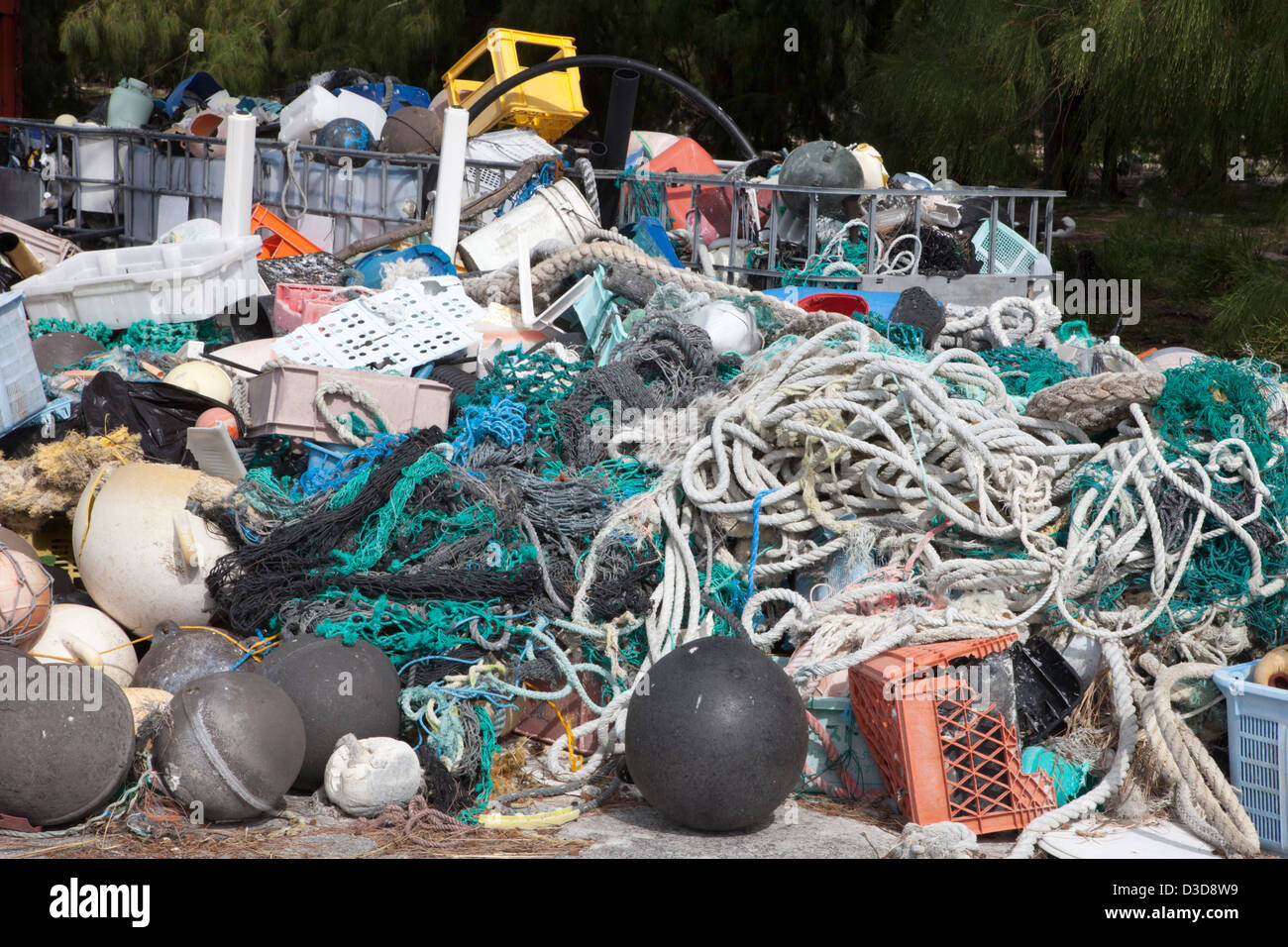 Marine debris that has washed ashore on Midway Atoll and was collected to be shipped off island for recycling or - Stock Image