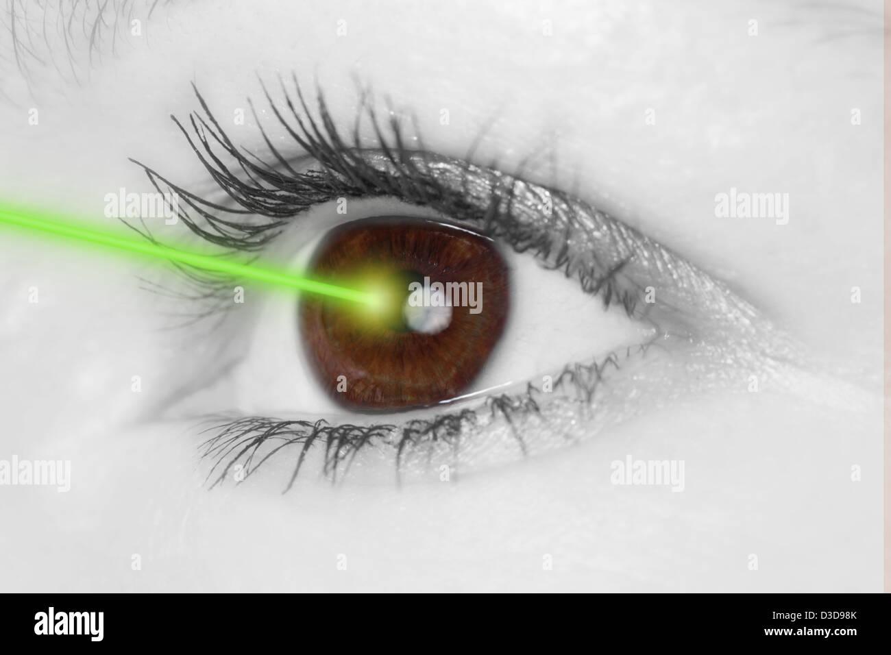 Eye with laser beam - Stock Image