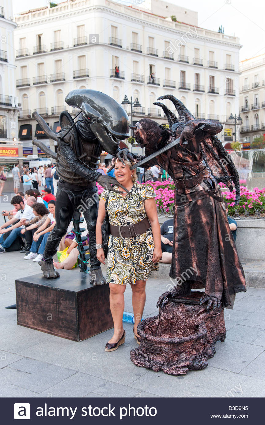 Scary living statue performers and tourist at Puerta del Sol, Madrid, Spain - Stock Image