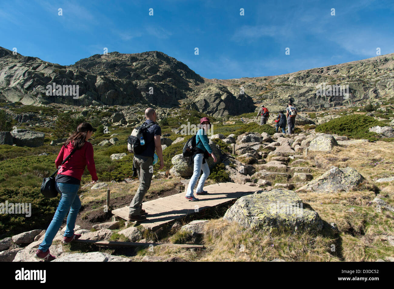 Young people hiking in the Penalara Nature Reserve on the Sierra de Guadarrama, Madrid, Spain Stock Photo