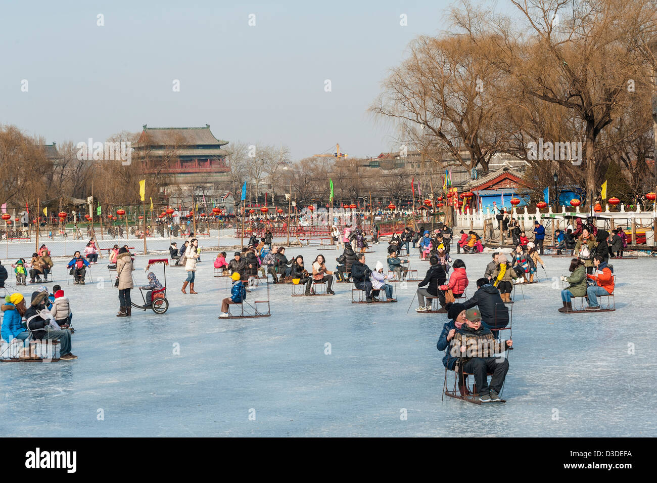 People have a fun with the sledge during the winter time, Beijing - Stock Image