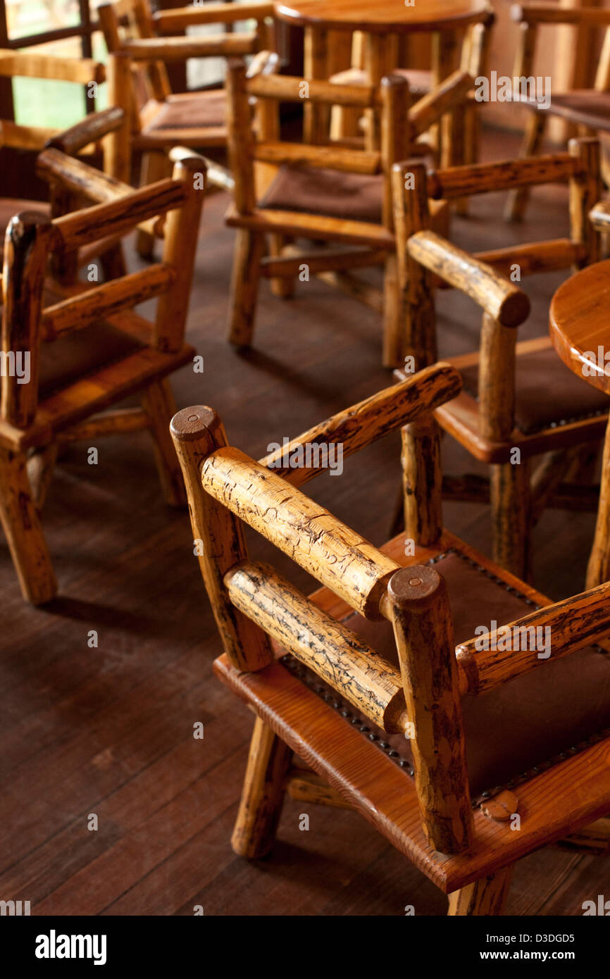 Wooden rustic hand made chairs in bar area of Mountain sky ranch, Montana, USA - Stock Image
