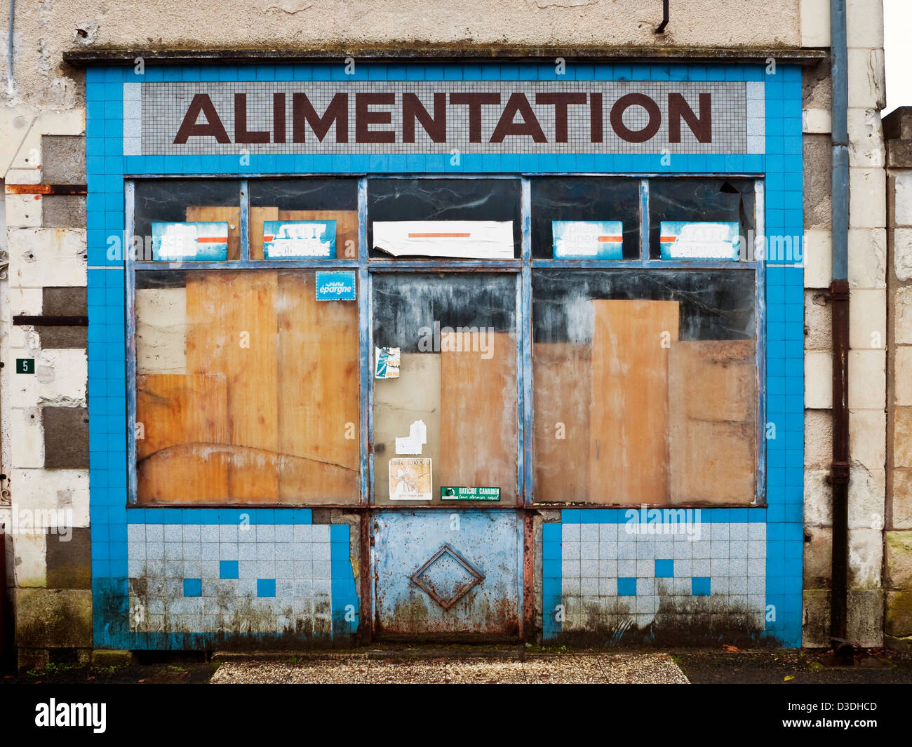 Closed-down shop front - France. - Stock Image