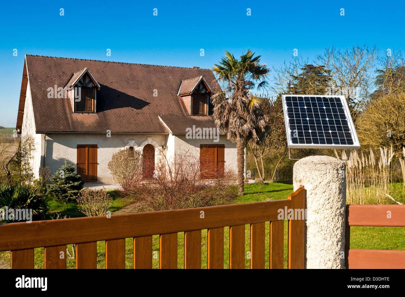 Solar panel on bungalow gatepost - France. - Stock Image