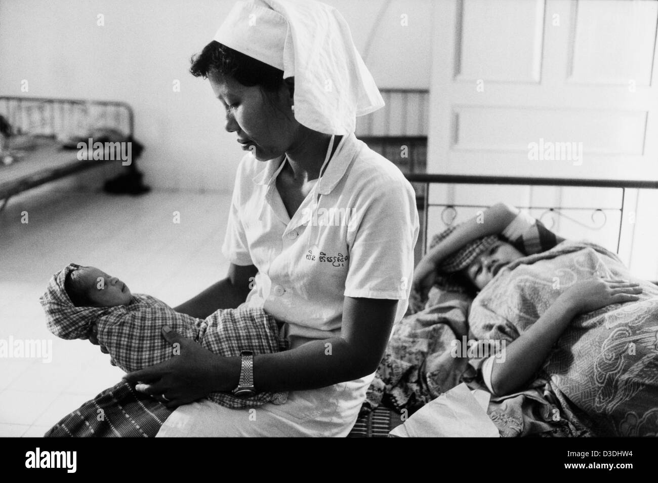 Cambodia: A nurse cares for a day old baby at a new health clinic in a rural area near to the capital. The clinic - Stock Image