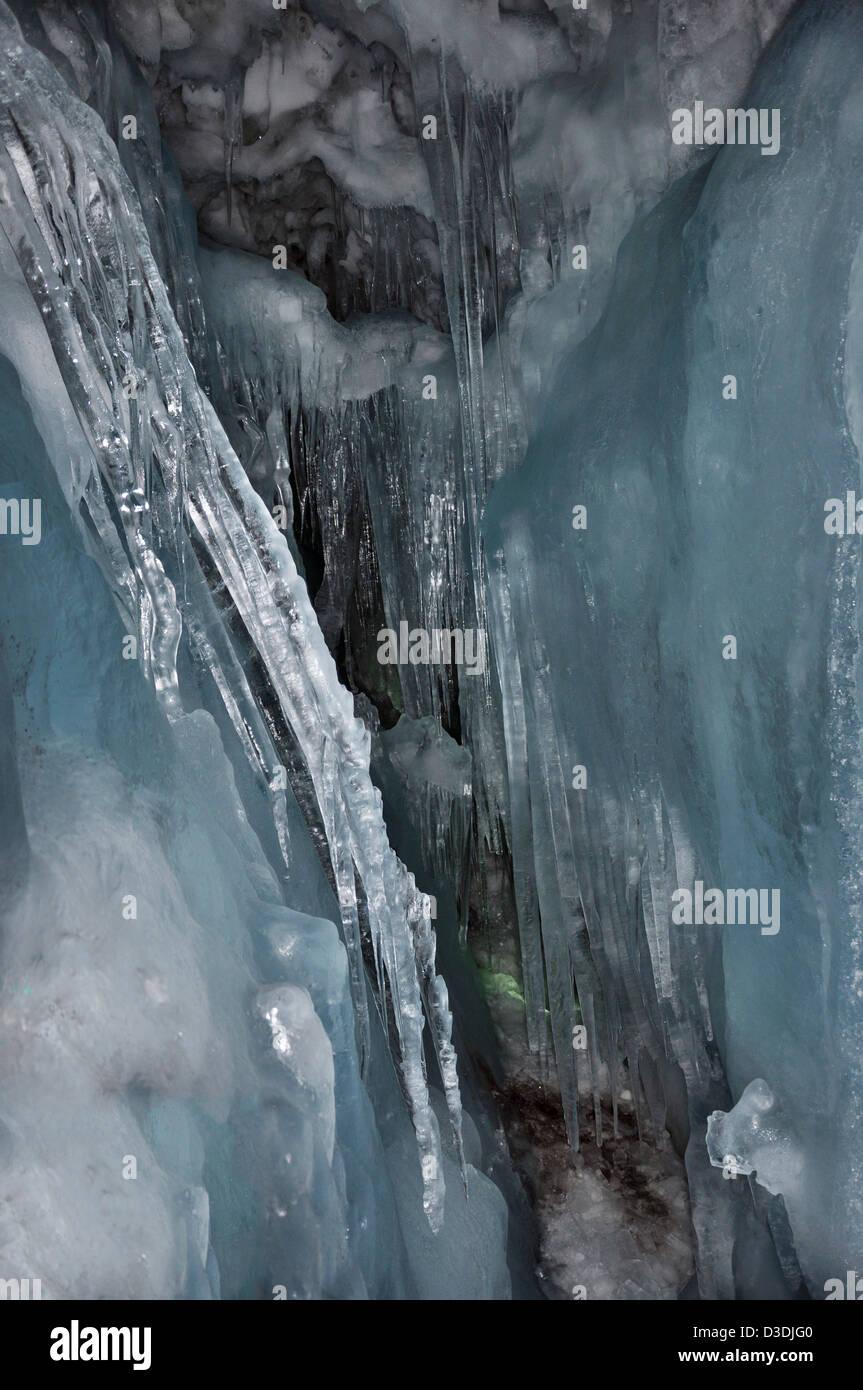Stalactites in a crevasse inside the Hintertux glacier in Zillertal Alps in Austria. - Stock Image