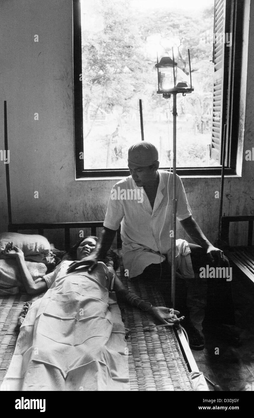 Kompong Speu, Cambodia: Patienton an I.V. drip at the town's hospital. - Stock Image