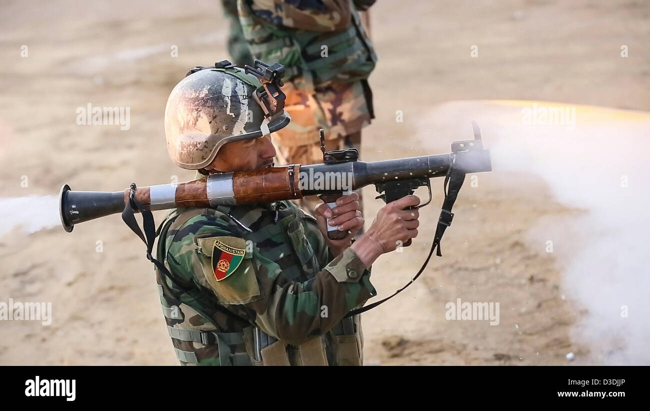 An Afghan commando practices firing a rocket propelled grenade during weapons practice on a firing range February - Stock Image