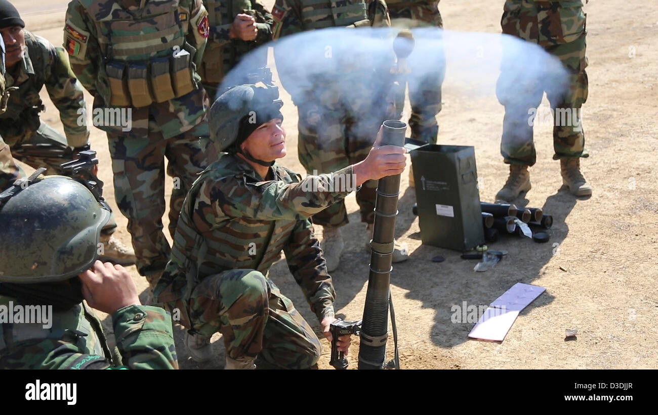 An Afghan commando practices firing a a 60mm mortar during weapons practice on a firing range February 16, 2013 - Stock Image
