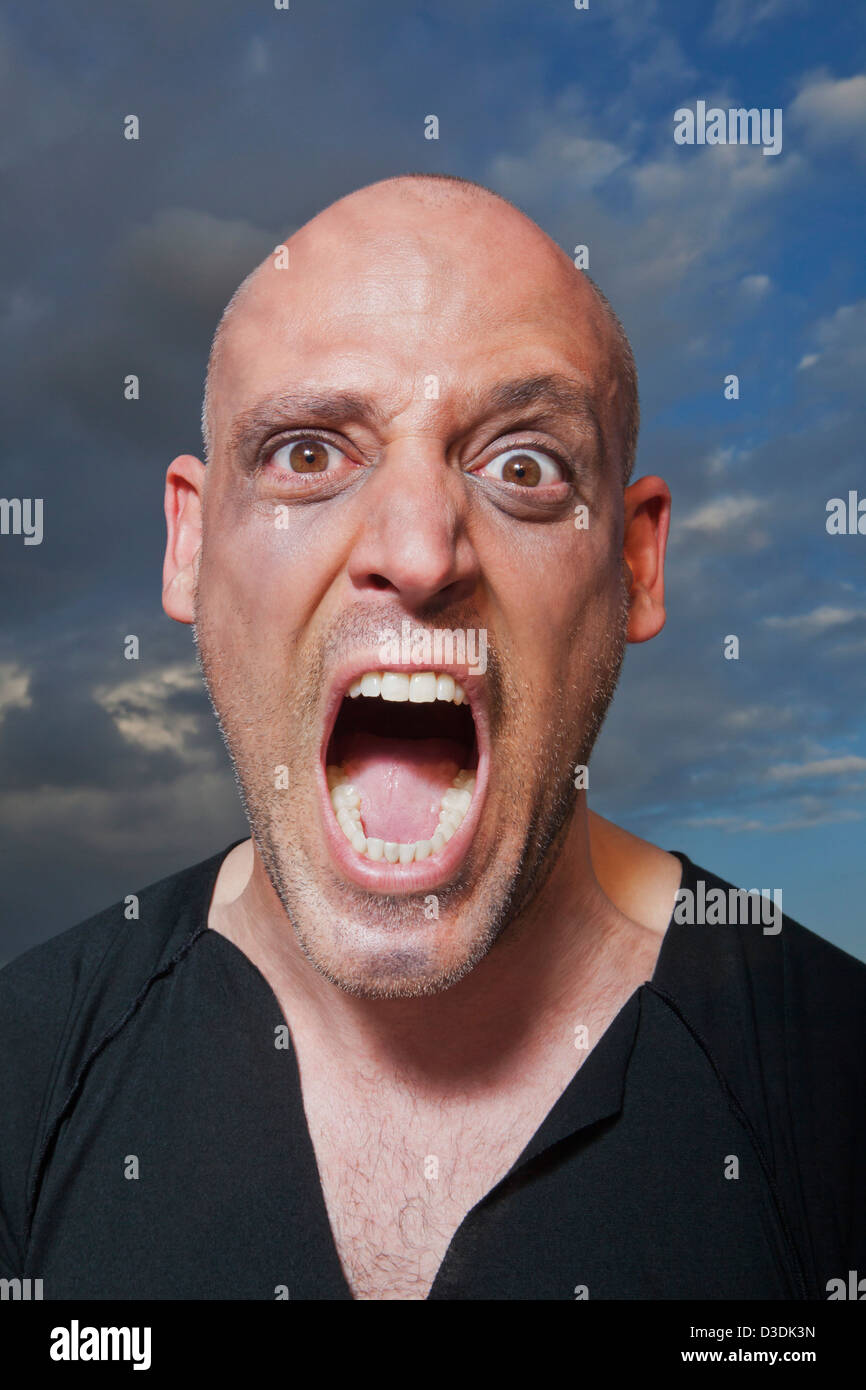 Portrait of a man shouting - Stock Image