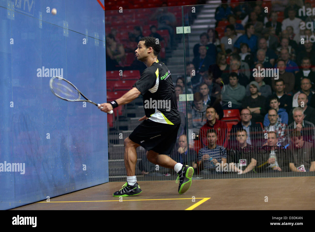 adrian grant makes a backhand return during his quarter-final match against peter barker at sportcity, manchester - Stock Image